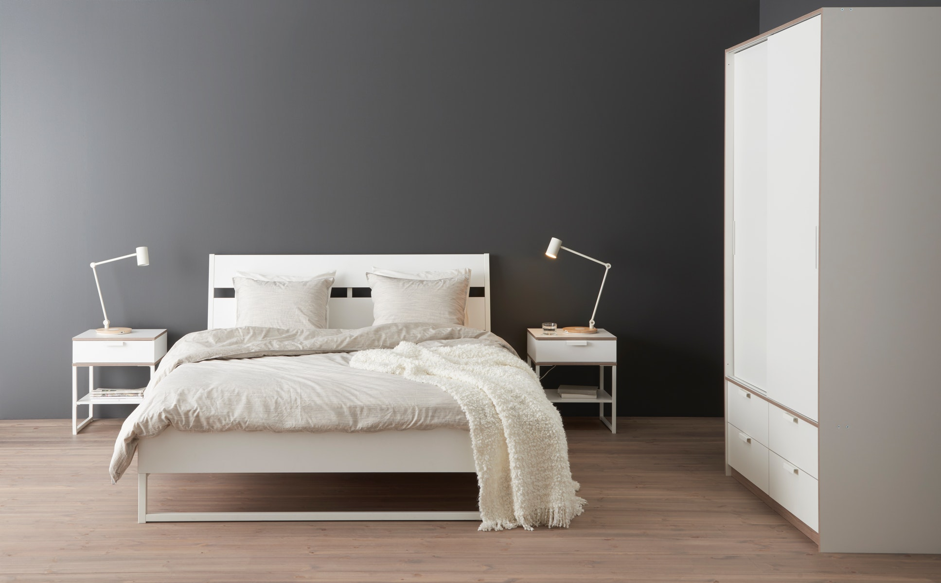 Are you up for some matching, modern, white bedroom furniture? Meet TRYSIL, featuring a bed, bedside table and a wardrobe with a clean, classy design. The angled headboard allows you to sit comfortably when reading in bed.
