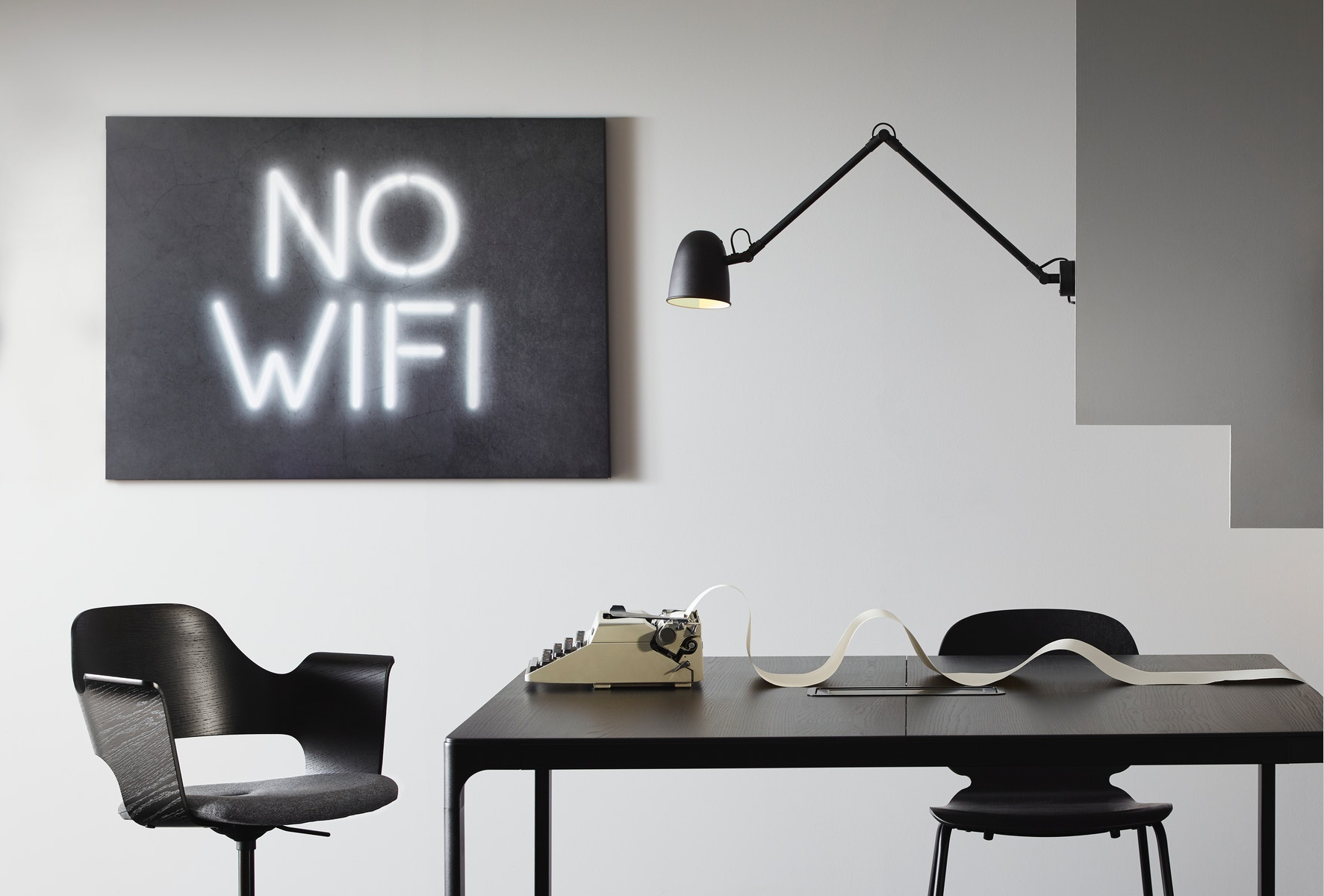 "This BJÖRKSTA picture features the text ""No wifi"" in white neon light on a dark background"