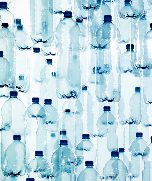 Clear plastic bottles with blue lids overlapping.