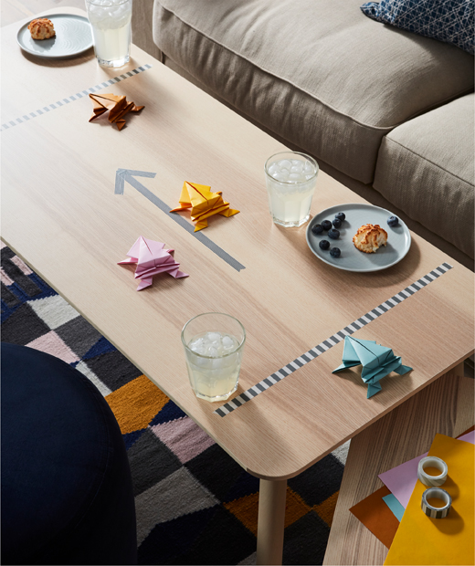 Coffee table with plates and glasses – drinks and snacks – and a racetrack with