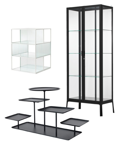 Three products designed to display collections. The tall, glass-fronted MILSBO cabinet with black frame, the SAMMANHANG glass display box and the SAMMANHANG black display stand with 5 trays.