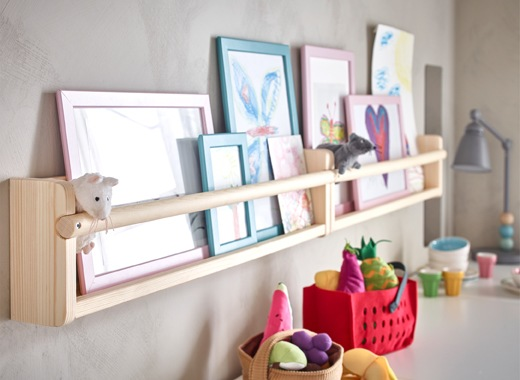 Pictures and toys displayed on two shelves side by side.
