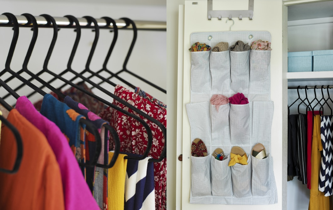 Black hangers inside a wardrobe with colourful clothes and accessories stored in a hanging shoe organiser inside the door of a wardrobe.