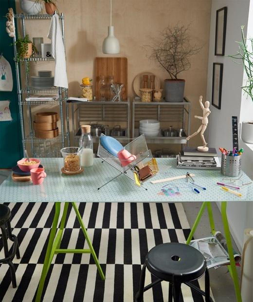廚房內有玻璃檯面餐檯,以乾碟架隔開,一邊用作餐檯,另一邊用作創意工作區。