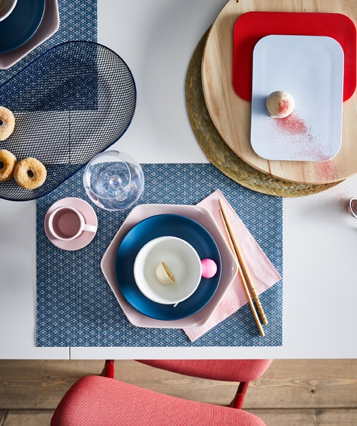 Section of dining table with an artful dessert setting for one, including coordinated colours, shapes and materials.