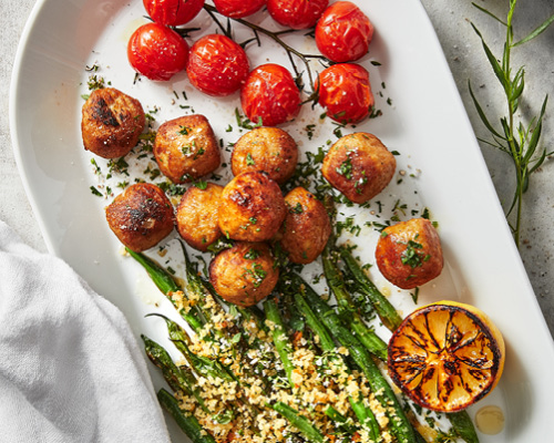 Chicken meatballs with roasted greens image