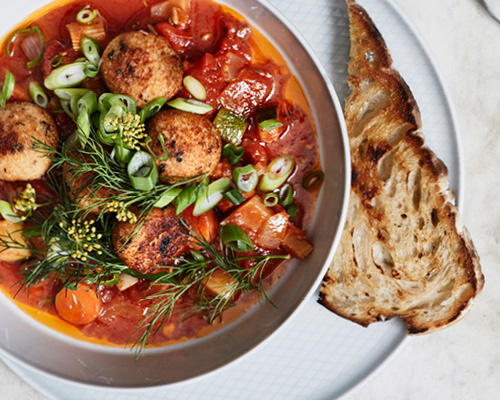 Salmon and cod balls with rustic tomato stew image